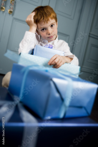ginger haired boy with lots of presents