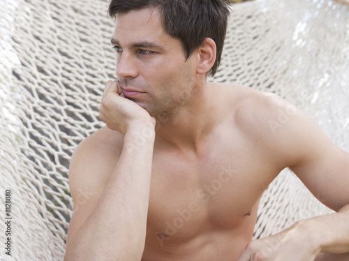 A man sitting in a hammock