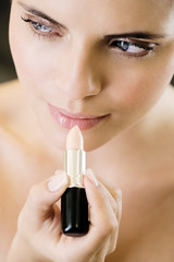 Woman applying lip gloss or top coat