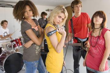 Group of teenagers (15-17) in garage band, portrait