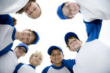 Little league baseball team standing in a circle