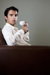 Portrait of a man drinking from an espresso cup