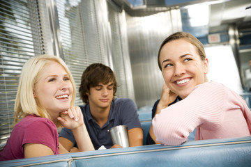 Portrait of smiling teenage girls with her friends in a diner