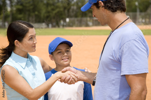 mother meeting her son's baseball coach