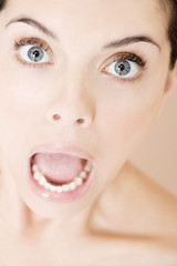 Young woman with mouth open in horror