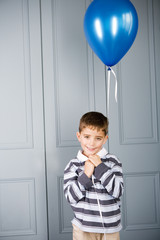 portrait boy holding balloon