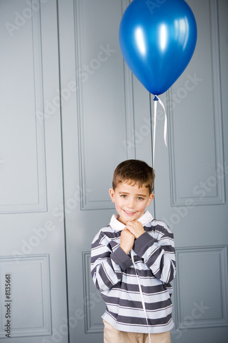 portrait boy holding balloon