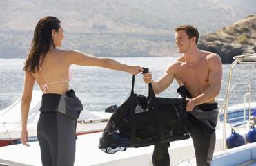 A couple preparing to scuba dive