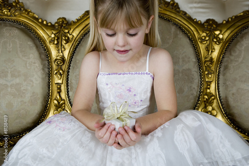 Little girl holding birthday present