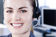 Smiling businesswoman in a call centre