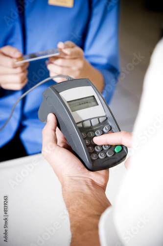 Man using a chip and pin machine at a supermarket
