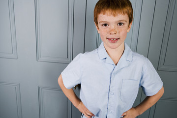 Indoor portrait boy with ginger hair
