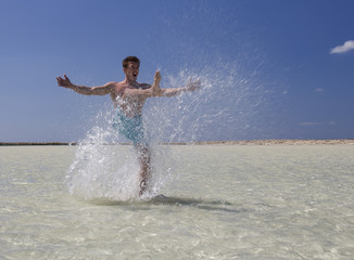 A man splashing in the sea