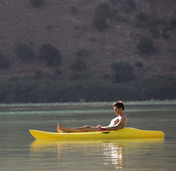 A man relaxing in a canoe
