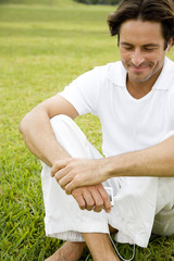 Man smiling sitting on the grass