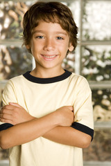 little boy smiling arms folded