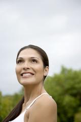 Portrait of a smiling Hispanic woman outside.
