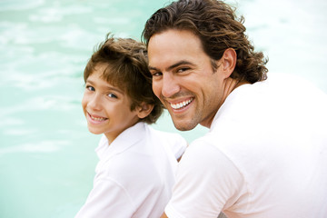 portrait of father and son by water