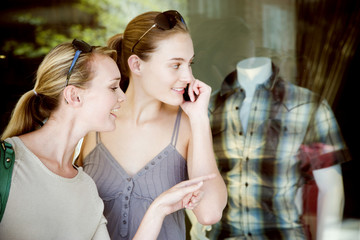 Two women window shopping