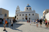 Main square and church in Oia, Santorini Greece poster