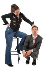 Girl carress sitting man