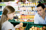 Supermarket shop assistant flirting with a customer