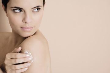 Woman applying moisturising cream