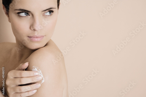 Woman applying moisturising cream