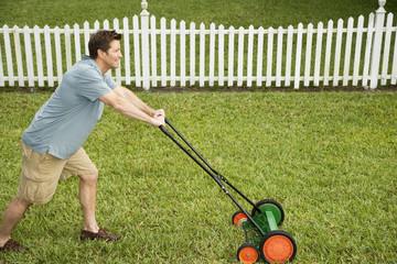man mowing the lawn\n