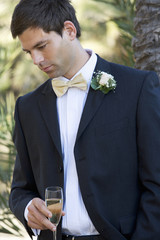 A groom drinking champagne