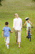 family walking and cycling in the countryside