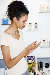 Woman looking at moisturisers at the beauty counter