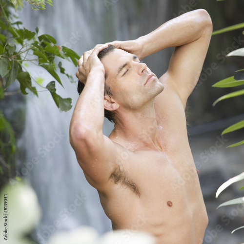 A man standing in a waterfall