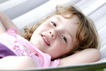 young Girl sleeping in a hammock