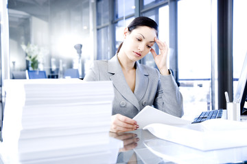 Businesswoman looking stressed with her paperwork