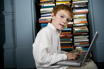 boy with laptop looking at camera