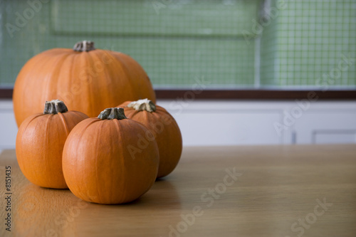 Orange Hallowe'en pumpkins on a kitchen table