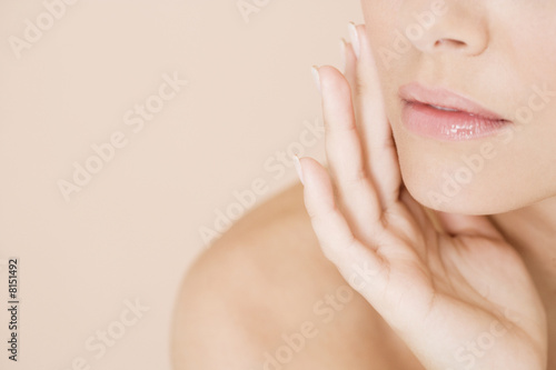Close-up of woman holding her hand to her face