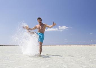 A man splashing in the sea