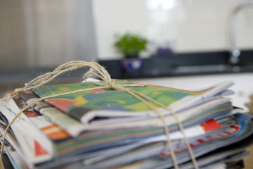 Bundle of newspapers tied with string, close-up