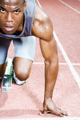 Portrait of a male athlete in the starting blocks