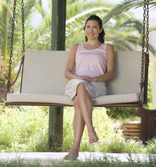 A woman relaxing on a swing