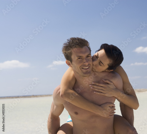 A romantic couple walking on a beach