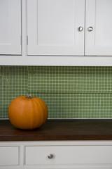 Orange Hallowe'en pumpkin on a kitchen counter
