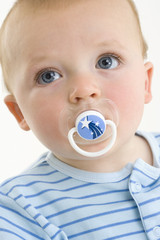 Baby boy (3-6 months) with pacifier in mouth, close-up