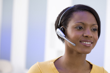 Woman in headset, smiling, close-up