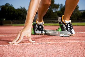Female athlete in the starting blocks