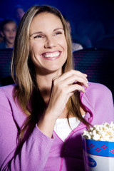 Woman enjoying a film at the cinema