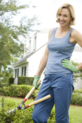 woman with garden shears hand on hip