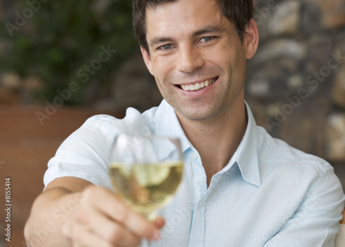 A man enjoying a glass of wine